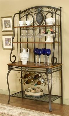 Cramco Ivy Hill Engraved Bakers Rack by Cramco. $479.46. Wine bakers rack. Shelves in pecan finish and entire frame & base in bronze finish. Four shelves. Made from pecan veneers and engraved metal. Wine bottle and wine glass storage. Make your dining room look more appealing by adding this Ivy Hill engraved Bronze Baker's Rack. The baker's rack features an antique Pecan finish, metal legs, three wood shelves, and wine racks that can hold up to eleven wine bottles.