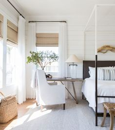 A warm white farmhouse bedroom designed by Marie Flanigan.