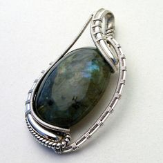 Hey, I found this really awesome Etsy listing at https://www.etsy.com/listing/225753790/labradorite-wire-wrap-pendant
