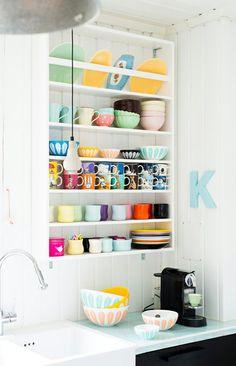 Open kitchen shelves - colorful mugs. Omg tons of mumin mugs