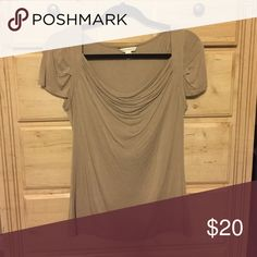 Short sleeve beige top Super cute top, some stretch, not too fitted. Can be dressed up or down. Very soft and comfy! Banana Republic Tops Blouses