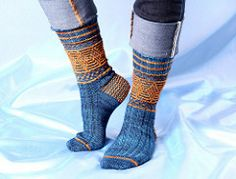 A tribute to the Quidditch players of Harry Potter's Wizarding World, or to any sock-loving Muggle, these colorwork socks are knit from the cuff down with a heel flap and gusset. The simple slipstitch technique requires working only one color at a time per row. Show your House colors with pride!