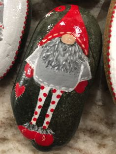 Christmas gnome painted rock by lolita Christmas Rock, Christmas Gnome, Christmas Projects, Holiday Crafts, Pebble Painting, Pebble Art, Stone Painting, Rock Painting, Rock Tattoo