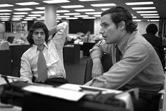 Watergate reporters Carl Bernstein, left, and Bob Woodward sit in the newsroom of the Washington Post, May 7, 1973. (Photo credit: AP archive)