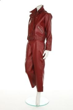A rare Belstaff womans wine-leatherette scooter suit, mid 1960s. labelled Scooterjak, Guaranteed windproof, waterproof, weatherproof, the press stud fastened jacket with zipped pockets and waist belt, matching trousers, chest 97cm, 38in, waist 77cm, 30in (2) Belstaff produced scooter and motorbike clothing for the Mods and Rockers market in the 60s, catering not only for the more traditional man but increasingly for women too.