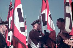 """""""Adolf Hitler at the swearing-in of SS standard bearers at the Reich Party Congress, Nuremberg."""" (Hugo Jaeger—Time & Life Pictures/Getty Images)"""