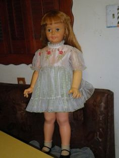 Patty Playpal doll with a size 3 dress from the 1950's - 1960's. Many of these dolls were dressed up in real toddler clothes from the that period.