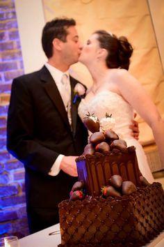 Chocolate groom's cake. Bride and groom strawberries.