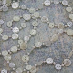 """Ivory Button Garland from The Holiday Barn...$19.50 Plastic, Button sizes: 5/8"""" diameter & 1/2"""" diameter, 6' length. I like the combination of buttons, pearl-like bead and the clear #11 glass seed beads.FAB!!!"""
