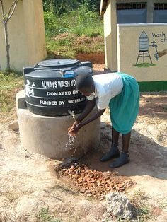 Convenient hand-washing stations make good hygiene practices simple. Hand Washing Station, Hand Hygiene, Made Goods, Uganda, Globe, Simple, Outdoor Decor, How To Make, Balloon