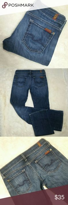 "7 For All Mankind Signature Bootcut Jeans Size 26 7 for all mankind dark wash bootcut signature jeans. Dark blue wash with subtle whisker washing in the thighs. Signature 7fam squiggle pockets in sleek navy threading. Button and zip fly. Preowned in great condition with no rips, holes, tears or stains. 98% cotton and 2% spandex makes for a comfy stretch denim. Long 34"" inseam. Size 26   Waist 14.5""  Rise 7.5"" Inseam 34"" Leg opening 9"" 7 For All Mankind Jeans Boot Cut"