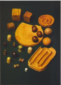 """Dice, carved pawns, balls carved of stone, and clay tracks unearthed at Mohenjo-Daro that they speculate were used to play games. Their findings include dice; solid stone boards; and small, carved """"pawns"""" that they speculate might have been used to play an ancient form of chess."""
