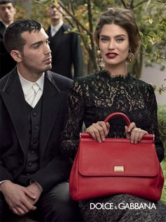 Dolce and Gabbana purse-also used to wack your husband over the head when he wont smile for a photo.