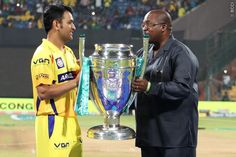 M S DHONI (Captain) of the Chennai Superkings receives the winners trophy during The Final of the Oppo Champions League Twenty20 between the Kolkata Knight Riders and the Chennai Superkings held at the M. Chinnaswamy Stadium, Bengaluru