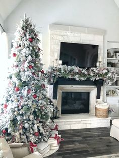 I& excited to share with you my Christmas home tour. This year I kept with a traditional color scheme with pops of red throughout my living room.