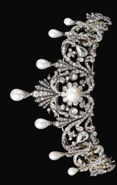 Natural pearl and diamond tiara, late 19th century. Of foliate scroll design, surmounted with seven drop-shaped natural pearls each in a mount embellished with rose diamonds, graduated in size from the centre, the scroll surrounds set with pear-, cushion-shaped and circular-cut diamonds, the button-shaped pearl at the centre of a cluster motif, may be detached into eight jewels, three may be worn as brooches, the two larger pear shaped diamonds are later additions