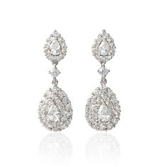 NEW: Double drop dangle earrings featuring 4 pear cut diamonds surrounded by clusters of round brilliant white diamonds 2.71ctw crafted in 18k white gold. $5,300 #wedding #jewelry