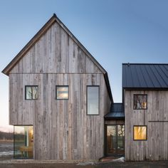 dezeen: LAMAS builds contemporary Canadian farmhouse with reclaimed timber walls