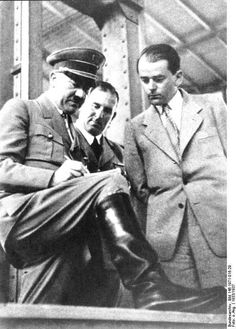 Adolf Hitler and Albert Speer in discussion, Nürnberg, Germany, circa 1933-1937. Hitler is most likely drawing an architectural sketch to discuss with Speer, his favorite architect.