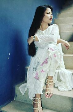 A traditional look on Eid.  White is always in for any occasion that too with a pinch of pinks and silver.