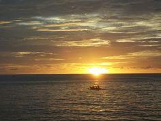 Fisherman's boat and sunset. (Location: Malalayang Beach, Manado, North Sulawesi.)