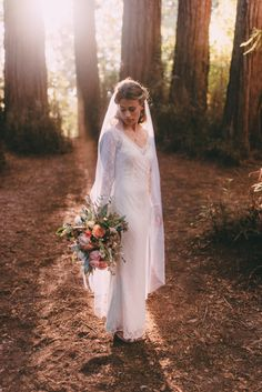 Our beautiful bride Misha in her customized stretch lace, long sleeved Isobel wedding dress. Misha requested that we add long, slim sleeves to her gown and to remove the train for a chic and laid back look. boho bride bohemian wedding