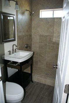 Dark floor tile and light shower tile