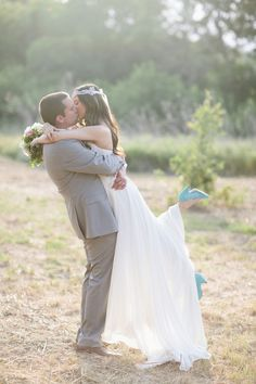gorgeous bride and groom kiss, with turquoise wedding shoes