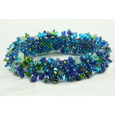 This 'Royal Seafoam' bracelet features a hand-woven base of Czech glass seed beads in shades of blue and green. The woven band of this bracelet is then richly fringed with an assortment of Czech glass beads and crystal stone chips.