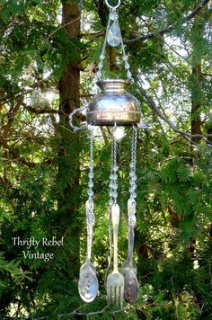 This repurposed silver creamer wind chime sounds lovely with the silverware tinkling in the breeze.