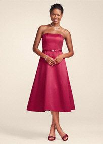 only $79.99 at David's Think the Holly would be ok.  http://www.davidsbridal.com/Product_Satin-Strapless-Rhinestone-Belted-Tea-Length-Dress-8355_Bridal-Party-Bridesmaids-Dresses-Under-$100