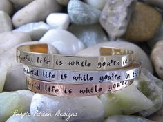 """Song Lyric Bracelet - How wonderful life is while you're in the world I've always loved these sweet lyrics. This bracelet reads """"How wonderful life is while you're in the world."""" Such a thoughtful gift for someone you love."""