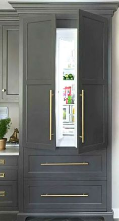 This is a really nice fridge that blends in with your cabinets. #remodel works www.remodelworks.com
