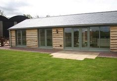 longbarnconversionblogexterior.gif (495×344) Barn Conversion Interiors, Bungalow Conversion, Wooden House Design, Small House Design, Country Modern Home, Self Build Houses, Agricultural Buildings, Long House, Barn Renovation