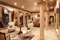 Elaborate mill work, inlaid imported hand-etched tile, Peruvian travertine columns, floors & one-of-kind custom iron doors