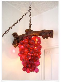 Glass grapes were everywhere.  Hanging as a light, filling up a glass bowl on the table, or just a bunch lying around.