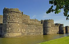 Beaumaris Castle, located in Beaumaris, Anglesey, Wales was built as part of King Edward I's campaign to conquer the north of Wales. It was designed by James of St. George and was begun in 1295, but never completed. Beaumaris has been designated as a World Heritage site.