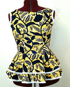 This is African print top with a flared double peplum, perfect for any occasion. Sizing Bust up to 48 Waist up to 38 This Item Is Made To Order . Please Provide The Bust, Waist and Height (For Petite sizes) Measurements When Making Your Order. If You Have Any Questions Please Contact Us. Thank You.