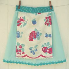 :: a pretty vintagey aqua half apron with a vintage fruity tablecloth mini apron adorned with vintage lace, dark aqua polka dot waist and ties and pretty dark aqua crocheted scallops!   ::Handmade with lots of love by me and ready to make you feel most lovely while in the kitchen or cleaning about