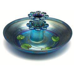 "Unusually nice L.C Tiffany bowl and flower frog, broad shape in blue favrile glass with a pulled green leaf and vine design, blue favrile glass two-tiered frog is removable, beautiful overall iridescence, both pieces signed L.C. Tiffany-Favrile, #5362L, 10.5""w x 5""h"