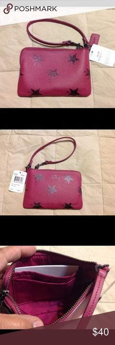 """Coach Star Canyon Wristlet NWT Super Cute Coach Star Canyon Wristlet.  One side of the wristlet strap detaches.  Zip closure opens to 2 card slots in interior.  Color is Cranberry.  6.5"""" x 4.25""""   NWT  NO TRADES Coach Bags Clutches & Wristlets"""