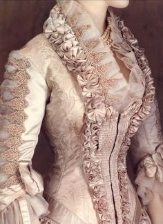 "Detail, Wedding gown by Worth, 1880s.  ""He was an artiste who was doing well.  He told me to pick out a nice dress for our wedding, and I chose a beautiful one in a shop window.  Days later he left me, and I spent five years paying off that dress.  I never saw him again."""