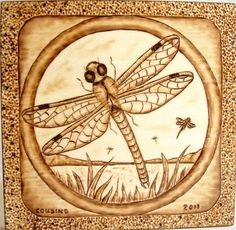 "Very Detailed pyrography | 2011, ""Dragonfly Lake"", bass wood with hanger"