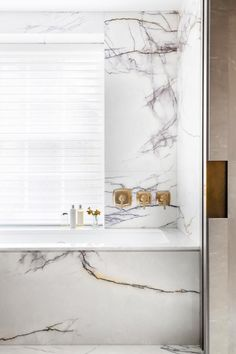What's more decadent than being surrounded with deeply veined marble when taking a bath? This setting makes us want to let the bubbles overflow—after all, isn't marble absorbent?