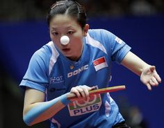 Timing is everything! In table tennis or photography... Singapore's Li Jiawei returns during the women final of the World Team Table Tennis championships between Singapore and China wearing Kinesio.