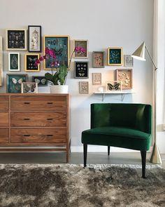 green velvet sofa & art