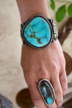 Authentic Native American Handmade Materials: 100% Sterling Silver Arizona Kingman Turquoise Artist: Nelvin Burbank, Navajo Tribe Product Description: Navaj