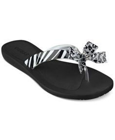 Guess dresses up the classic flip flop with a decorative bow for a sweet touch. | Imported | Rubber upper | Bow detail on strap | Man-made sole | Web ID:573660