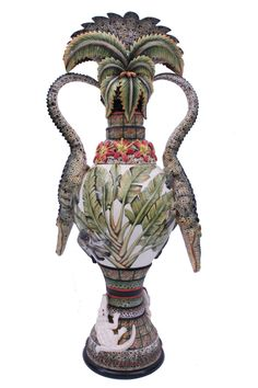 Zambezi Croco Vase, Masterwork no. 3  Sabelo Khosa's natural flair for classical thrown forms and sculptural rhythms, has created this elegant piece. Painter, Mandela Ngwenya has lovingly payed it homage by embellishing and enriching the surface with crocodile, leopard print,and geometric pattern.
