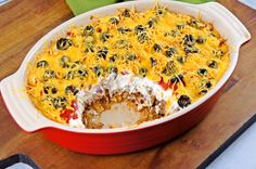 Mexican Casserole - Layer tortilla chips on bottom, mixture of ground beef, salsa, chili... then sour cream topped with tomatoes, black olives, & cheese! Bake 30 minutes at 350.